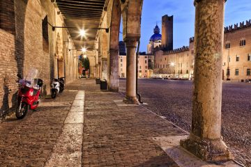 stock-photo-europe-italy-mantua-ancient-roman-town-and-ducale-residence-at-sunset-central-square-covered-with-222603589.jpg